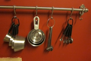 measuring cups bar on wall